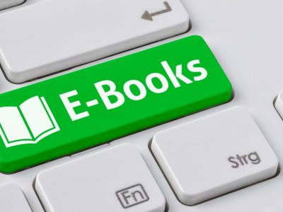 A keyboard with a green button - E-Books